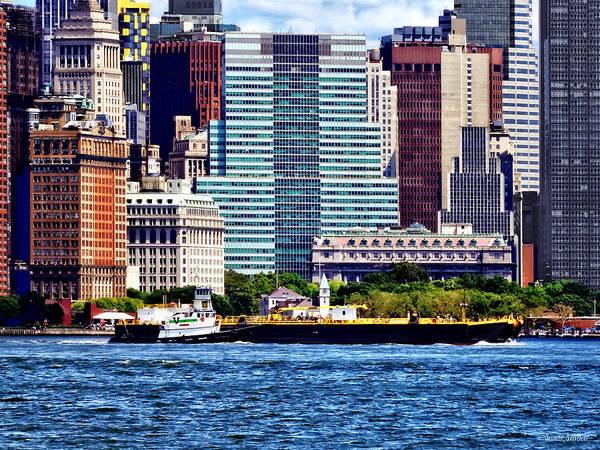 Photograph - Tugboat Pushing Barge Near Manhattan Skyline by Susan Savad