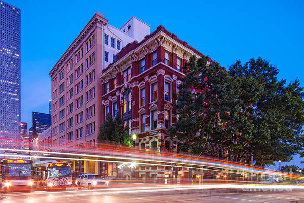 Shutter Speed Photograph - Twilight Blue Hour Shot Of The Cotton Exchange Building In Downtown Houston - Harris County Texas  by Silvio Ligutti