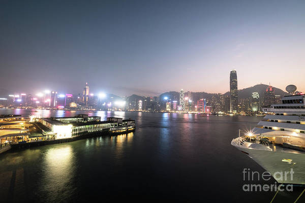 Photograph - Twilight Over The Victoria Harbor And Star Ferry Terminal In Hon by Didier Marti