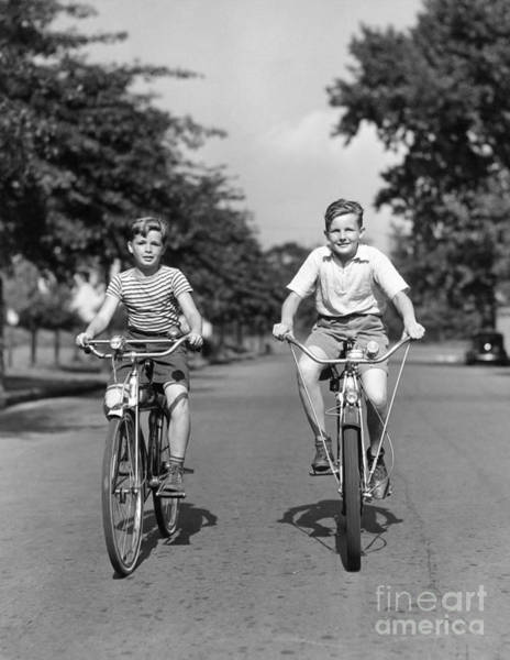 Photograph - Two Boys Riding Bikes, C.1930-40s by H Armstrong Roberts ClassicStock