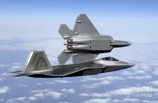 Jet Fighter Photograph - Two F-22a Raptors In Flight by Stocktrek Images
