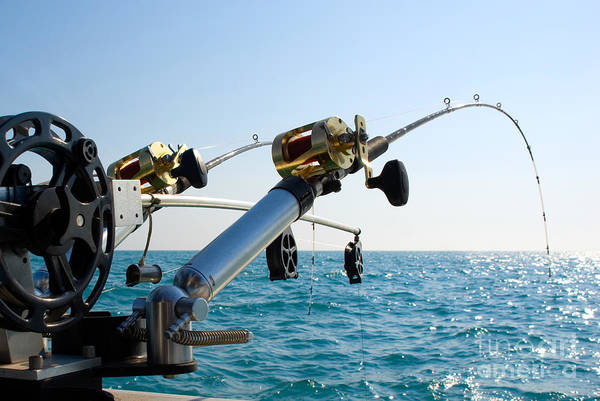 Angling Photograph - Two Fishing Poles On Back Of Boat by Paul Velgos