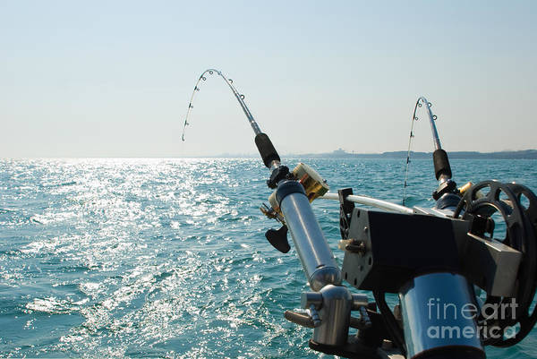 Angling Photograph - Two Fishing Rods On Back Of Boat by Paul Velgos