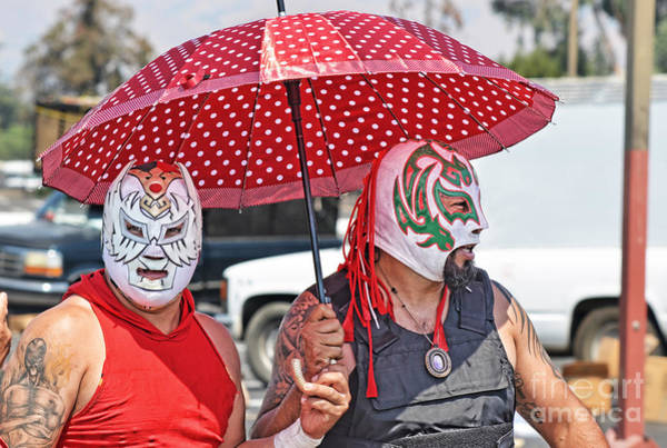 Pro Wrestler Wall Art - Photograph - Two Luchadores Going For A Stroll On A Hot Afternoon by Jim Fitzpatrick