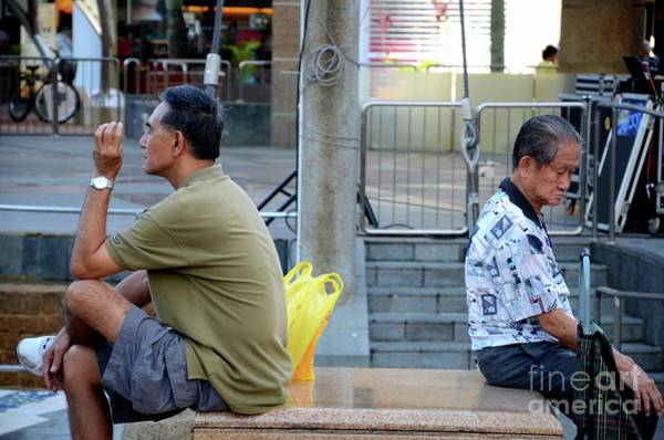 Photograph - Two Men Sit Back To Back In A Public Square In Singapore Toa Payoh Hdb Estate by Imran Ahmed