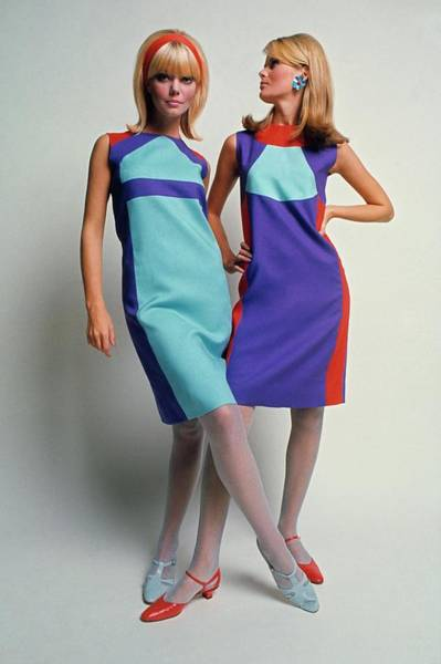 Blue Flower Photograph - Two Models In Colorblock Dresses by David McCabe