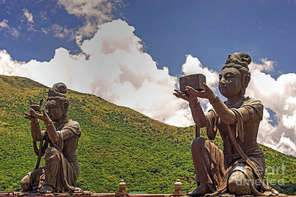 Giant Buddha Photograph - Two Of The Six Devas Give Offerings To The Tian Tan Buddha by Chris Smith