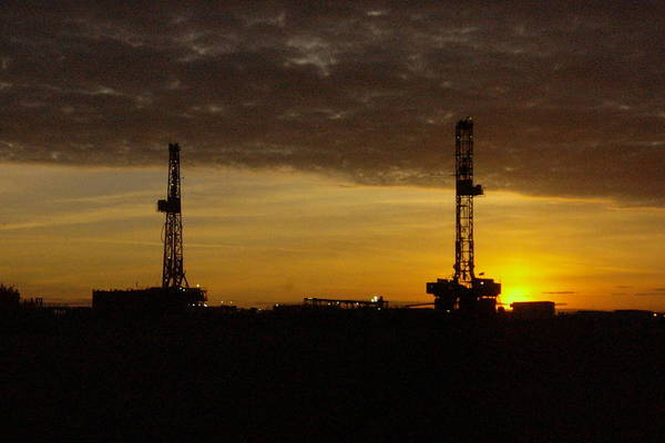 Wall Art - Photograph - Two Oil Rigs At Sunrise by Jeff Swan