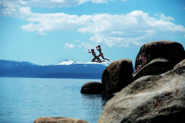 Photograph - Two People Jumping Into The Cold Water Of Lake Tahoe by Dan Friend