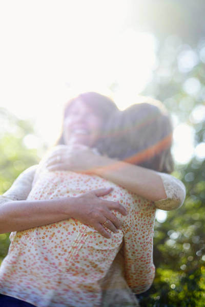 Wall Art - Photograph - Two Women Hugging Each Other by Gillham Studios