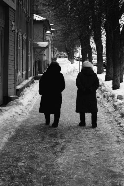 Photograph - Two Women In Winter Clothes Walking Away by John Williams