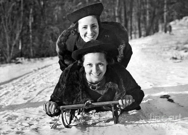 Comedy Photograph - Two Young Women On A Sled by American School