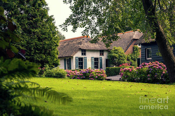 Photograph - typical dutch county side of houses and gardens, Giethoorn by Ariadna De Raadt