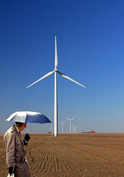 Ear Muffs Photograph - Umbrella Man And Wind Power by Christopher McKenzie