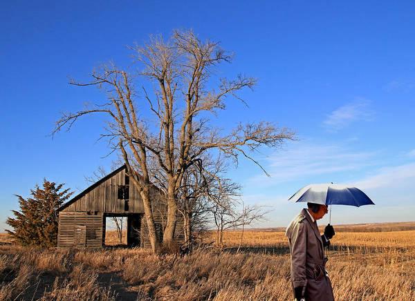 Ear Muffs Photograph - Umbrella Man In Lower Nebraska by Christopher McKenzie