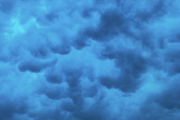Photograph - Under The Clouds by Tyson Kinnison