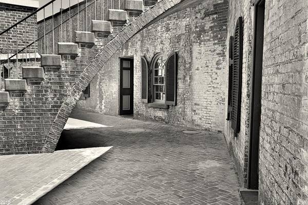 Photograph - Under The Stairs At Fort Macon Black And White by Lisa Wooten