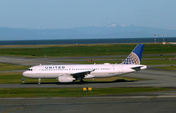 Vancouver International Airport Wall Art - Photograph - United Airlines A320-200 Taxis To The Active Yvr Runway by Darrell MacIver
