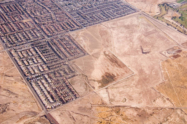 Subdivision Photograph - Urban Sprawl Creeps Out Into The Desert by Taylor S. Kennedy