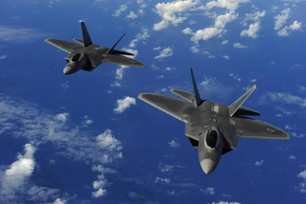 Photograph - U.s. Air Force F-22 Raptors In Flight by Stocktrek Images