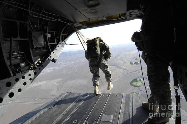 Skydiver Photograph - U.s. Airmen Jump From A Ch-47 Chinook by Stocktrek Images