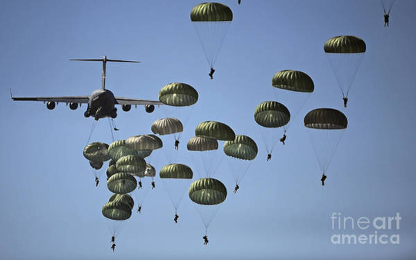 Jumping Photograph - U.s. Army Paratroopers Jumping by Stocktrek Images
