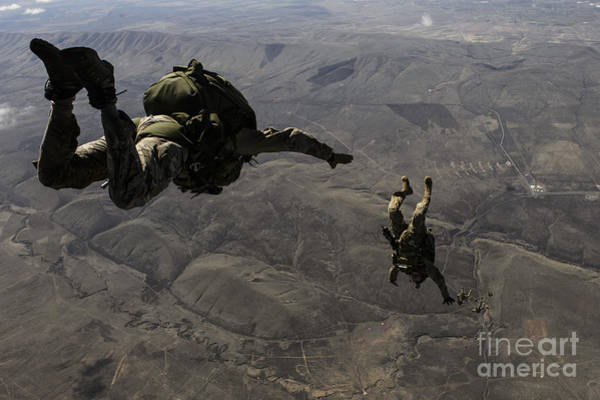 Skydiver Photograph - U.s. Army Soldiers Conduct A Halo Jump by Stocktrek Images