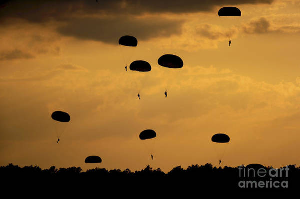 Photograph - U.s. Army Soldiers Parachute by Stocktrek Images