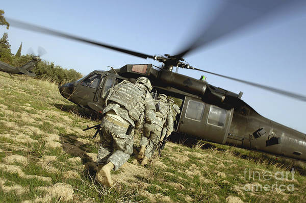 Utility Helicopter Photograph - U.s. Army Soldiers Prepare To Board by Stocktrek Images