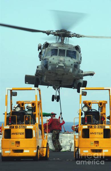 Photograph - U.s. Navy Sailors Attach A Sling by Stocktrek Images