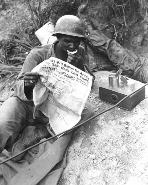 Battleground Photograph - U.s. Soldier Reads The Latest News by Stocktrek Images