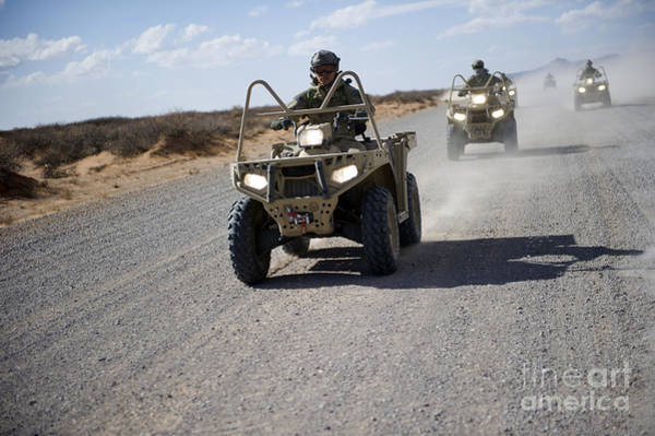Four Wheeler Photograph - U.s. Soldiers Perform Maneuvers by Stocktrek Images