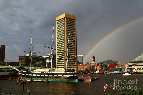Photograph - Uss Constellation Rainbow And Inner Harbor Baltimore by James Brunker