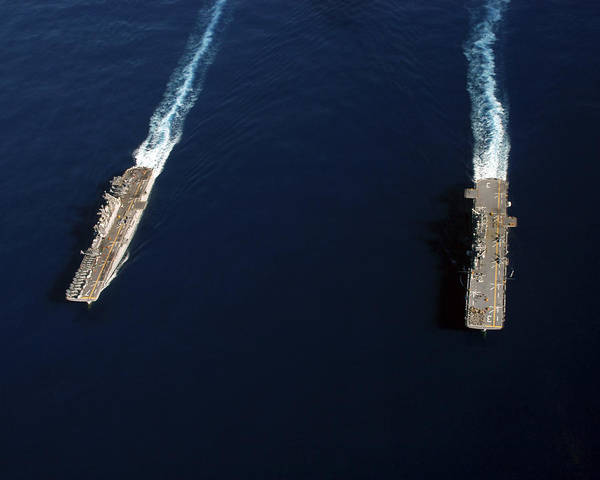 Amphibious Assault Ship Wall Art - Photograph - Uss Iwo Jima Steams Alongside Uss by Stocktrek Images