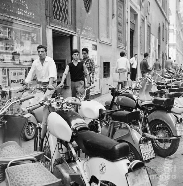 Wall Art - Photograph - Various Scooters, Including Lambretta And Vespa, Parked On A Str by The Harrington Collection