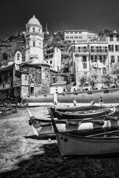 Photograph - Vernazza Boats And Church Cinque Terre Italy Bw by Joan Carroll