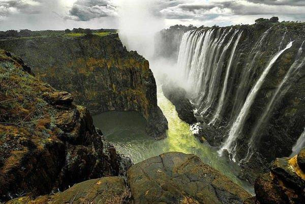 Abstract Skyline Wall Art - Photograph - Victoria Falls Zambia And Zimbabwe  by Andy Bucaille