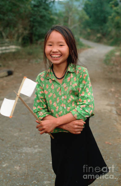 Photograph - Vietnamese Girl With White Paper Flags by Silva Wischeropp
