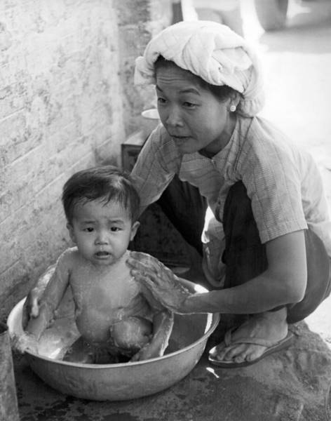 Wall Art - Photograph - Vietnamese Orphan Bathing by Underwood Archives