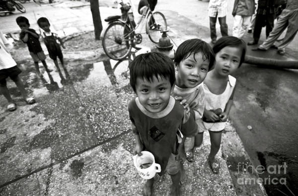 Photograph - Vietnamese Street Children Playing With A Goldfish by Silva Wischeropp