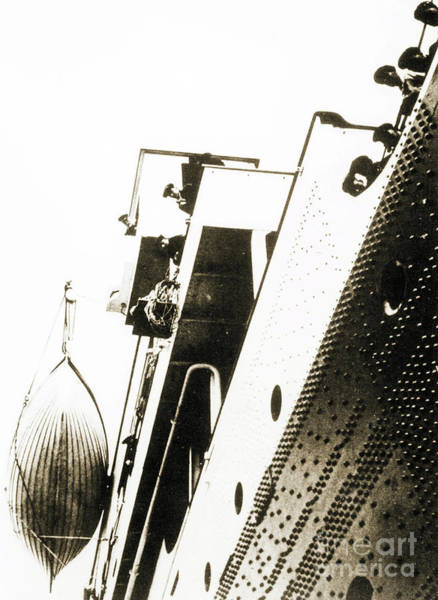 Lifeboat Photograph - View Of The Bottom Of One Of The Titanic Lifeboats From The Dock by English School