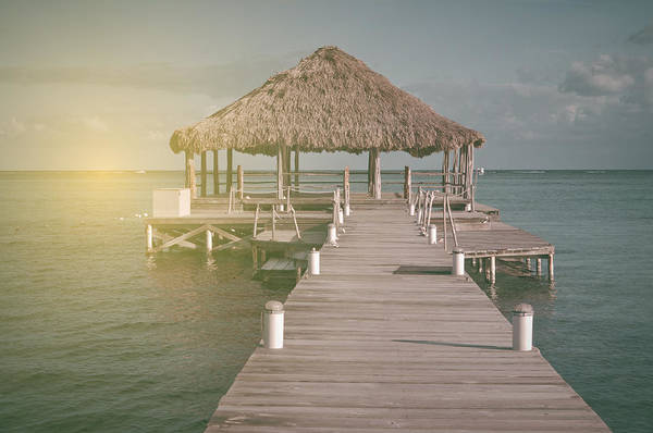 Ambergris Caye Photograph - Vintage Beach Deck With Palapa Floating In The Water With Vintag by Brandon Bourdages
