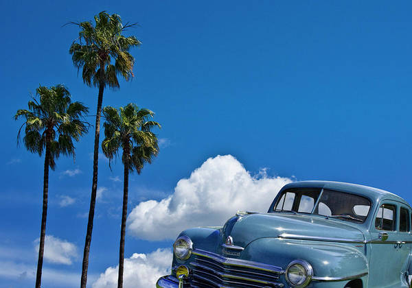 Photograph - Vintage Blue Plymouth Automobile Against Palm Trees by Randall Nyhof