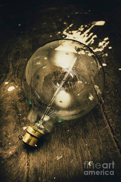 Electricity Photograph - Vintage Light Bulb On Wooden Table by Jorgo Photography - Wall Art Gallery