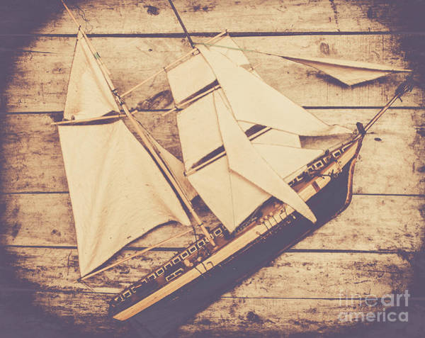 Photograph - Vintage Mini Ship On Wooden Background by Jorgo Photography - Wall Art Gallery