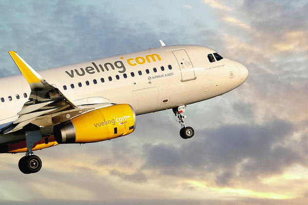 Airbus A320 Wall Art - Photograph - Vueling Airbus A320-232 by Smart Aviation