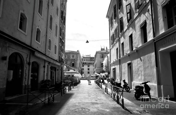 Photograph - Walking Alone In Marseille by John Rizzuto