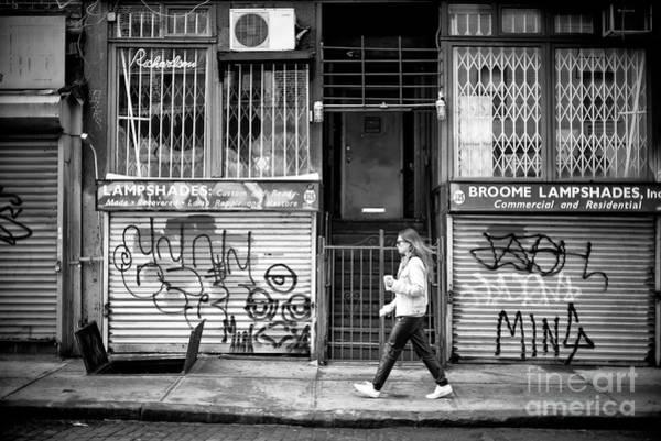 Photograph - Walking Through The Bowery by John Rizzuto