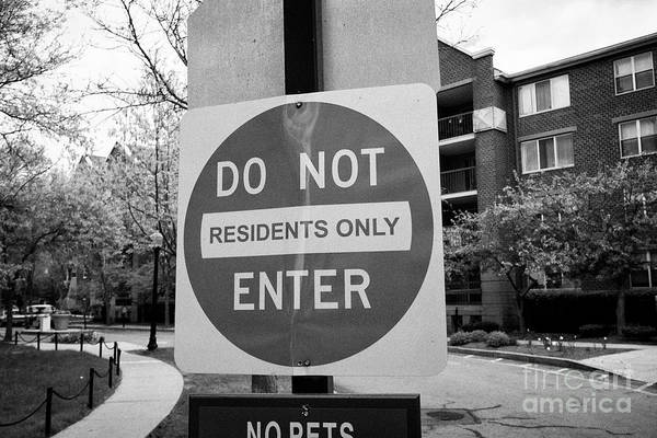 Wall Art - Photograph - warning no entry sign do not enter residents only housing complex Boston USA by Joe Fox