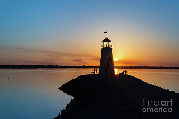 Photograph - Watching The Sunset Under The Lighthouse by Paul Quinn